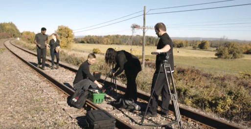Movie crew on railway tracks