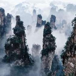 Zhangjiajie, or the Avatar Mountains, are a cluster of sandstone columns unlike any national park. With direct flights from many major cities in China, Zhangjiajie is easily accessible. It is also home to the longest and highest glass bridge which is perfect for the thrill-seeker.