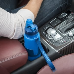 Nomader collapsible water bottle in car cup holder